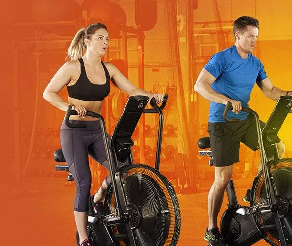 man and woman exercise using elliptical machine