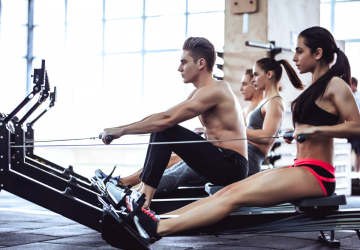 fit man and woman working out in the gym