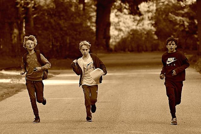 boys running happily