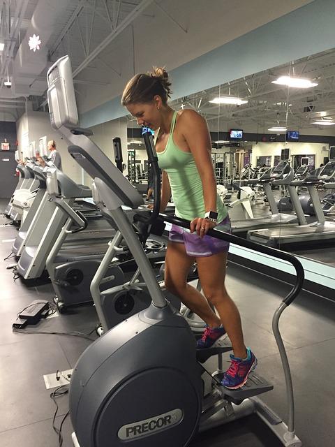 woman doing elliptical training