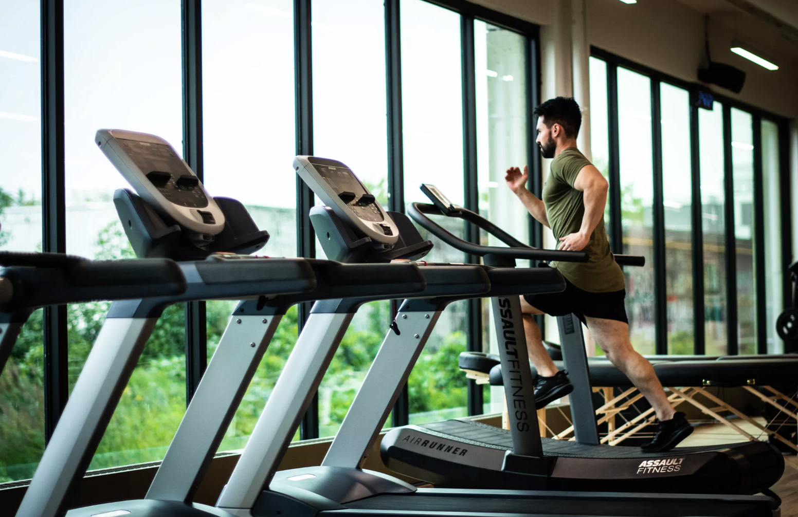 man in the gym using treadmill