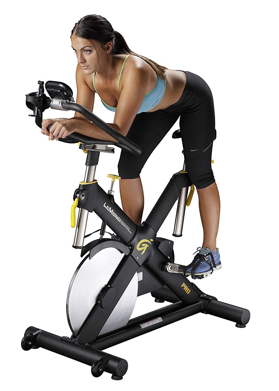 Woman using  Lemond Revmaster Pro Exercise Bike